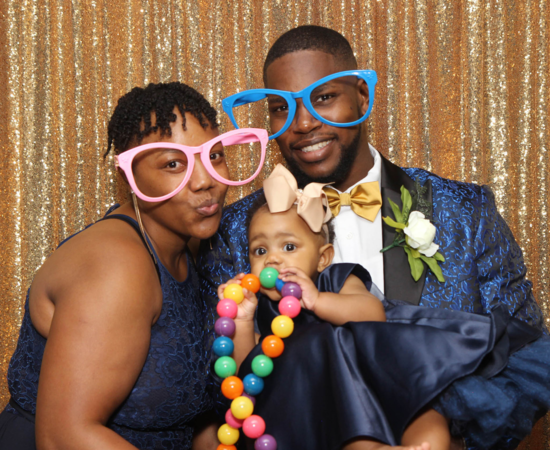 couple having fun with the photo booth at a wedding